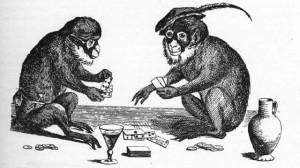 deux singes jouant au cartes